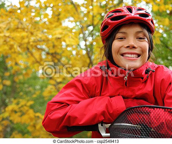 Woman biking - csp2549413