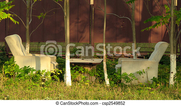 two arm chairs hear the fence in the farm - csp2549852