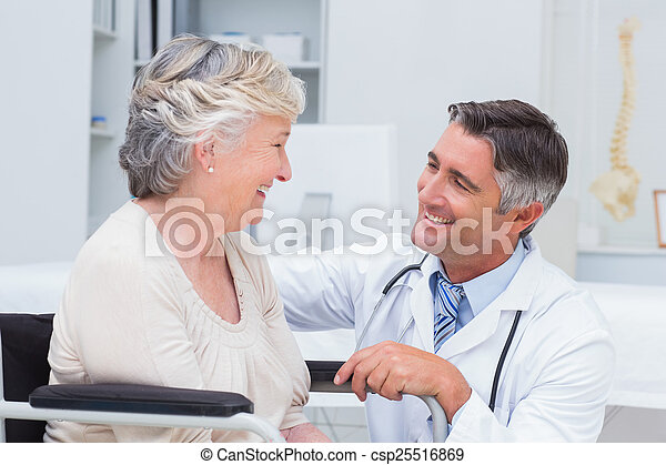 Male doctor looking at female patient