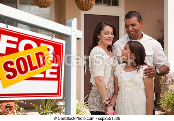 Hispanic Family in Front of Their New Home with Sold Sign - csp2551826