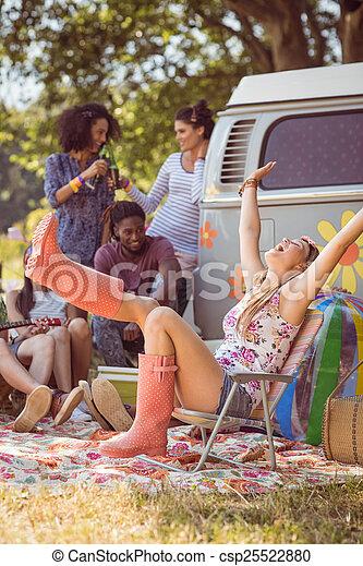 Carefree hipster having fun on campsite - csp25522880