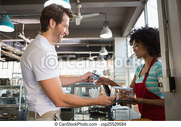 Smiling customer paying by card