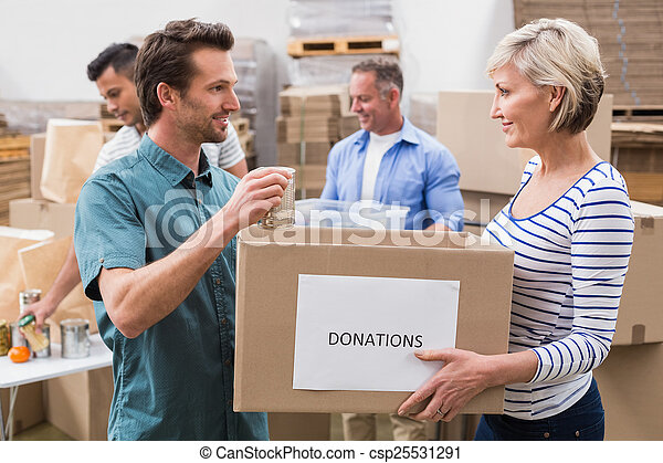 Two volunteers holding a donations box