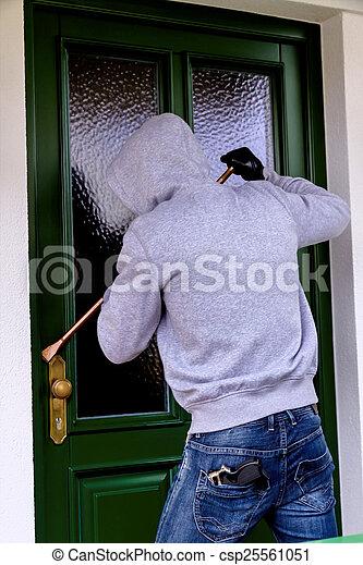 burglar at a house door - csp25561051