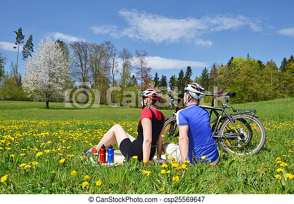 Travelers having rest in Alpine meadow