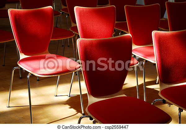 many red chairs standing in row with light and shadow - csp2559447