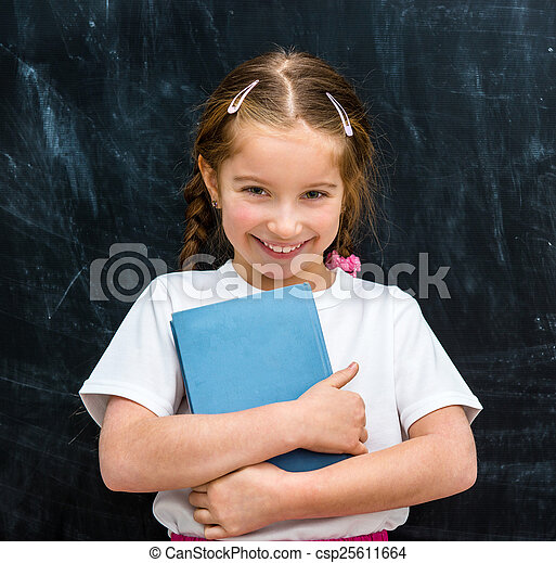 little girl with book in hands