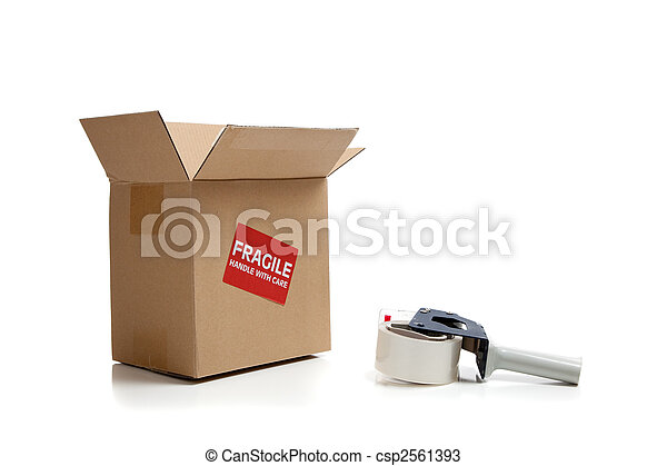 Cardboard shipping box with a tape gun - csp2561393