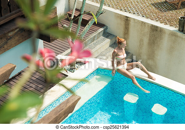 Stock Photographs Of Young Woman Wearing Swimsuit Relaxing Near Swimming Pool At Csp25621394