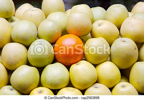 accumulated apples whit a orange - csp2563898