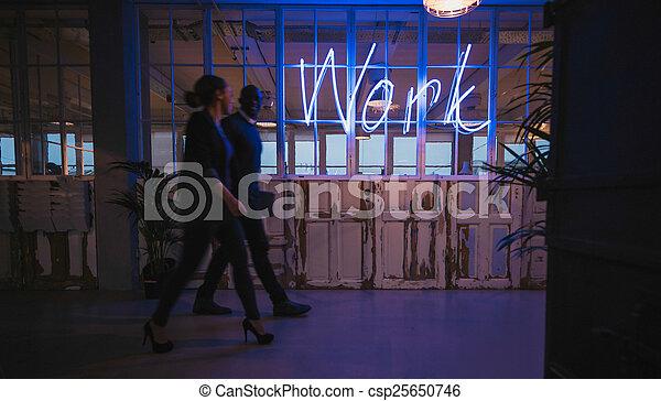 Business executive walking through office corridor