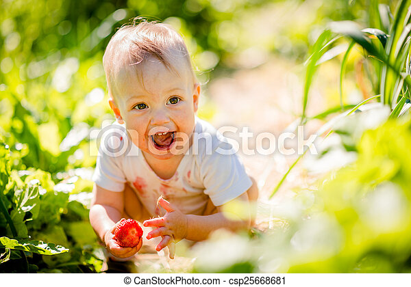 Little child with strawberry