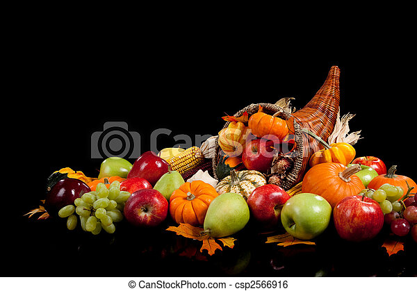 Fall arrangement of fruits and vegetables in a cornucopia - csp2566916