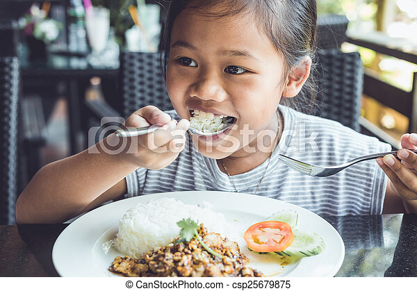 Thai children eating in restaurant