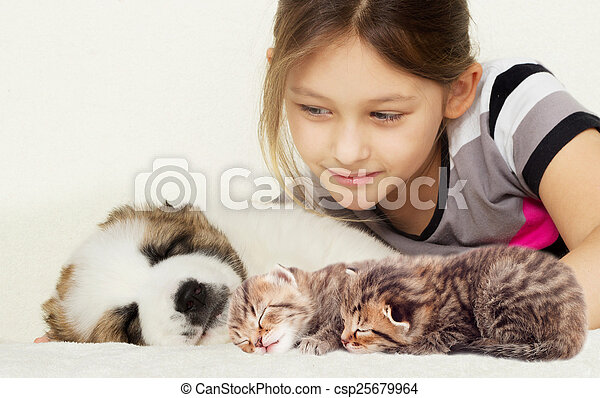 child and a kitten and puppy