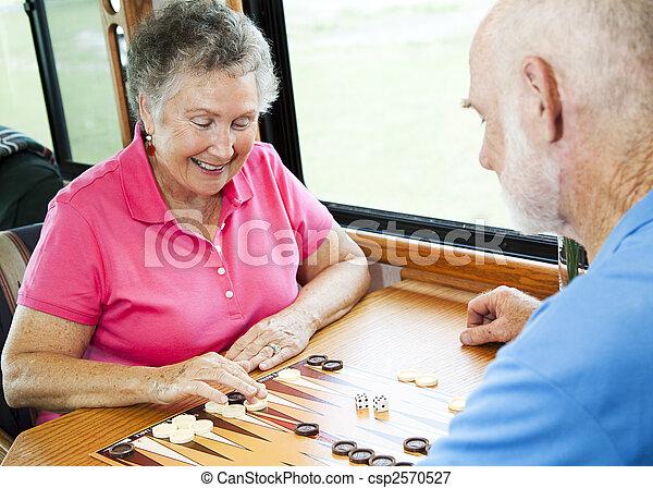 RV Seniors Play Board Game - csp2570527