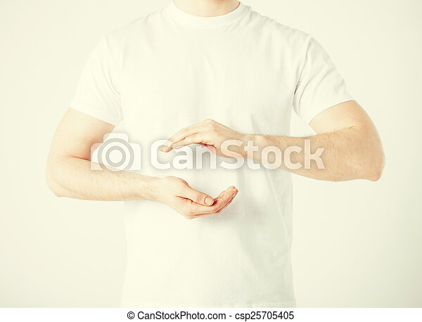 mans hands showing something - csp25705405