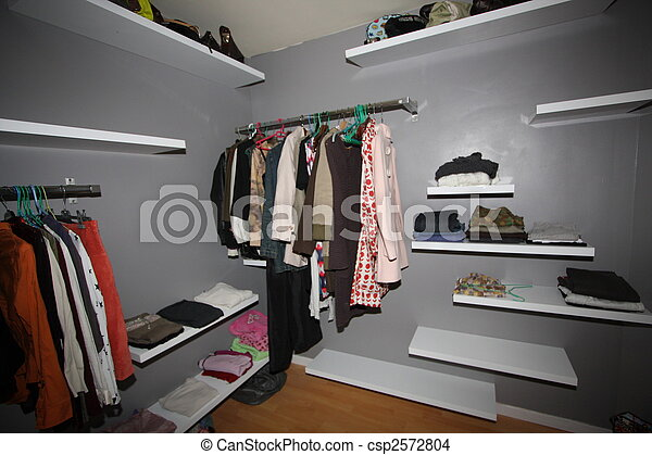 some clothes organized in a closet - csp2572804