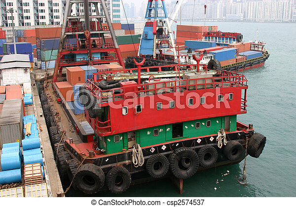 A container barge being loaded with containers in Victoria Harbour - Hong Kong - csp2574537