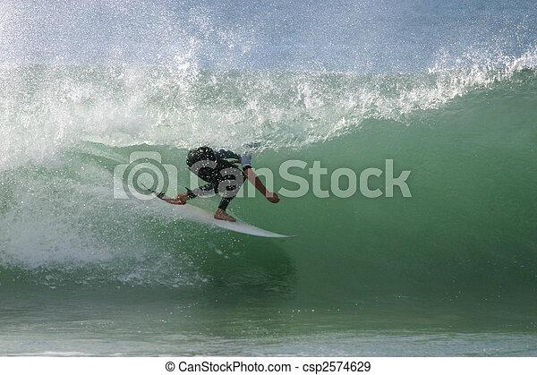 A surfer rides the tube at a beachbreak. Newcastle Australia  - csp2574629