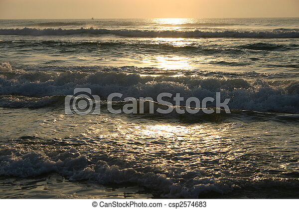 The sun shines over the waves on a beautiful sunny morning - csp2574683