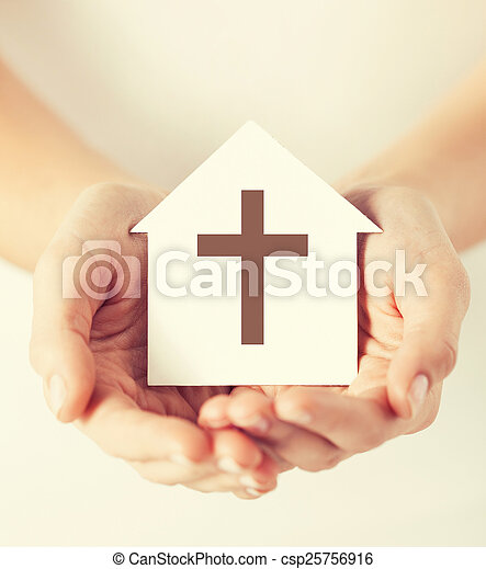 religion, christianity and charity concept - female hands holding paper house with christian cross symbol