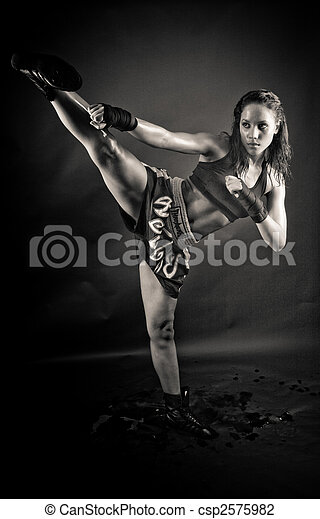 Beautiful girl kicking with the leg  - csp2575982