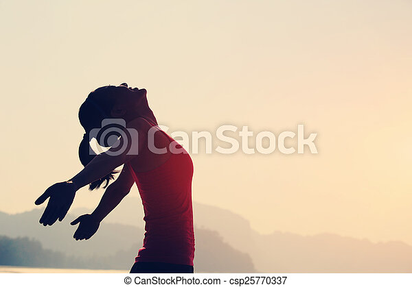young woman open arms seaside