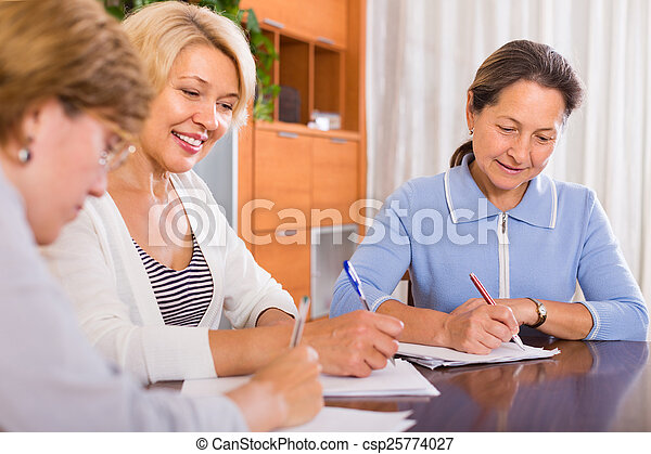 Mature women working with documents