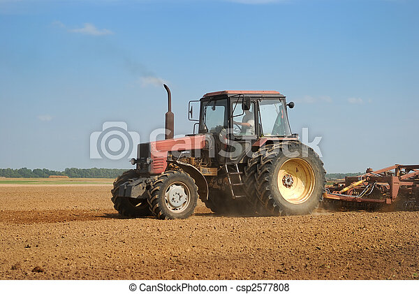 Agriculture ploughing tractor outdoors - csp2577808