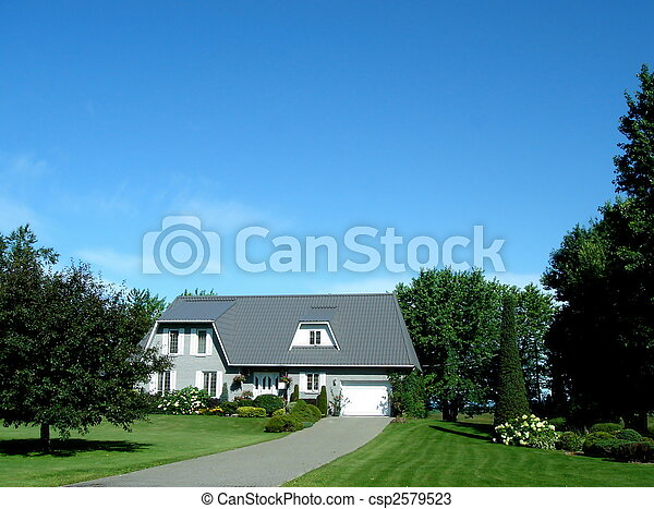 White house and cropped lawn and vegetation with deep blue sky - csp2579523