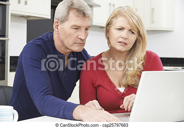 Worried Mature Couple Reviewing Domestic Finances