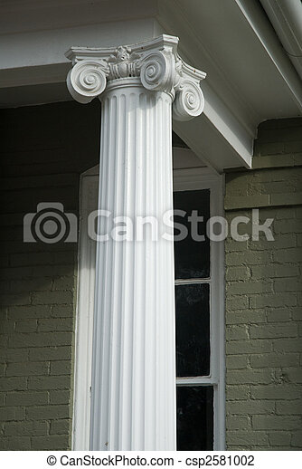 Decorative column on porch of old house