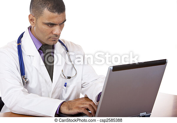 Medical doctor reviewing his notes on laptop - csp2585388