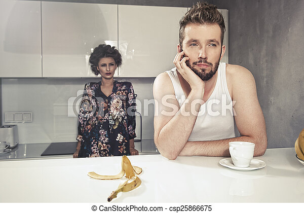 Funny couple after breakfast. Strange faces.  - csp25866675