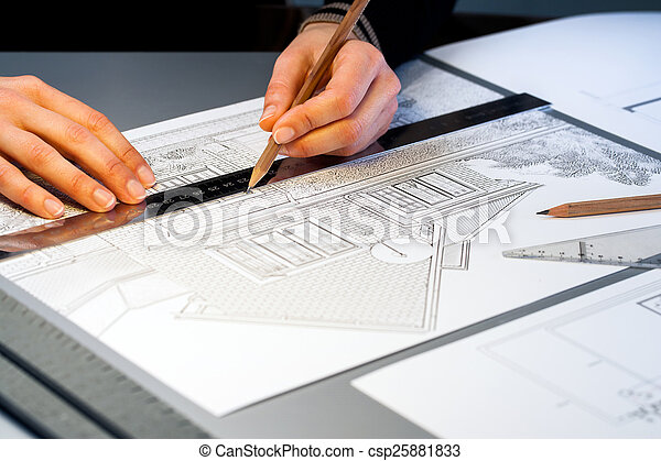 Hands working on architectural documents. - csp25881833