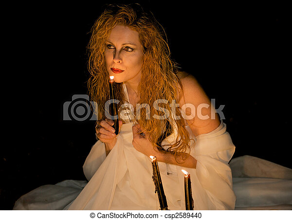 Attractive woman blowing out a candle. - csp2589440