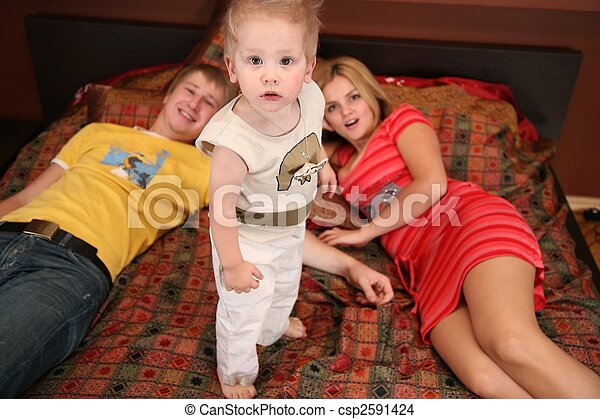 parents with child on carpet 2