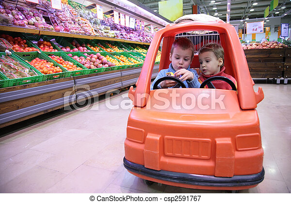 children in toy automobile in store - csp2591767