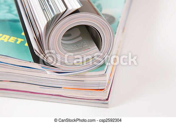 curled magazined on stack - csp2592304