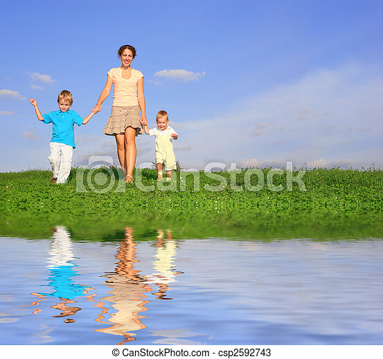 mother with children on meadow and water - csp2592743