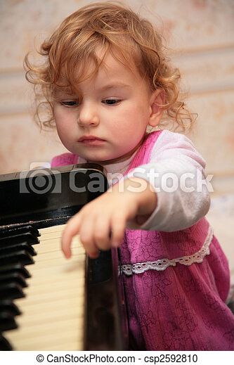 little girl and piano - csp2592810