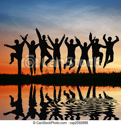 silhouette jump team. sunset pond - csp2592888