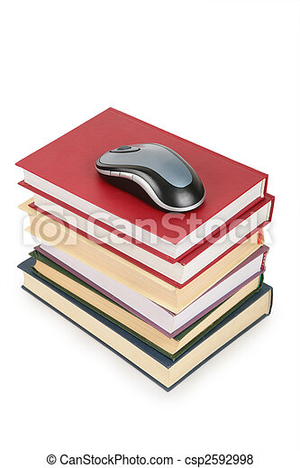 computer`s mouse on pile of books - csp2592998