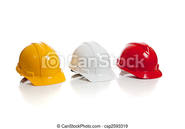 Various hard hats on a white background - csp2593319