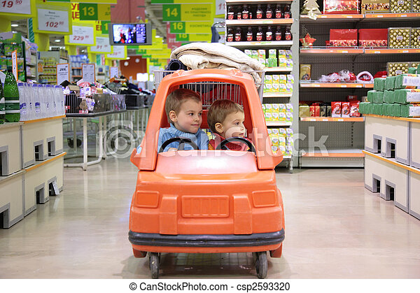 children in toy automobile in supermarket - csp2593320