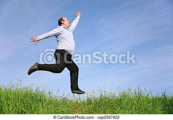 fat man jumps on meadow - csp2597422