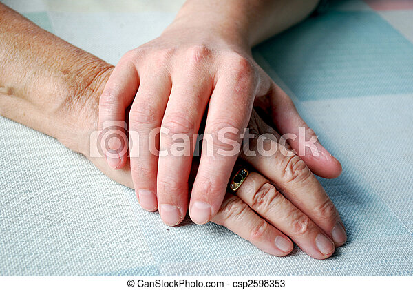 close-up of two hands on the table with daylight. - csp2598353