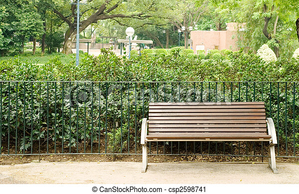 Brown bench with nobody in the park - csp2598741