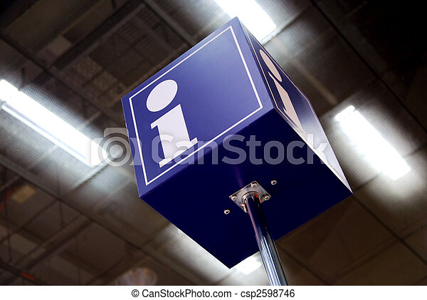 tourist information sign in a station with neon lights in background - csp2598746